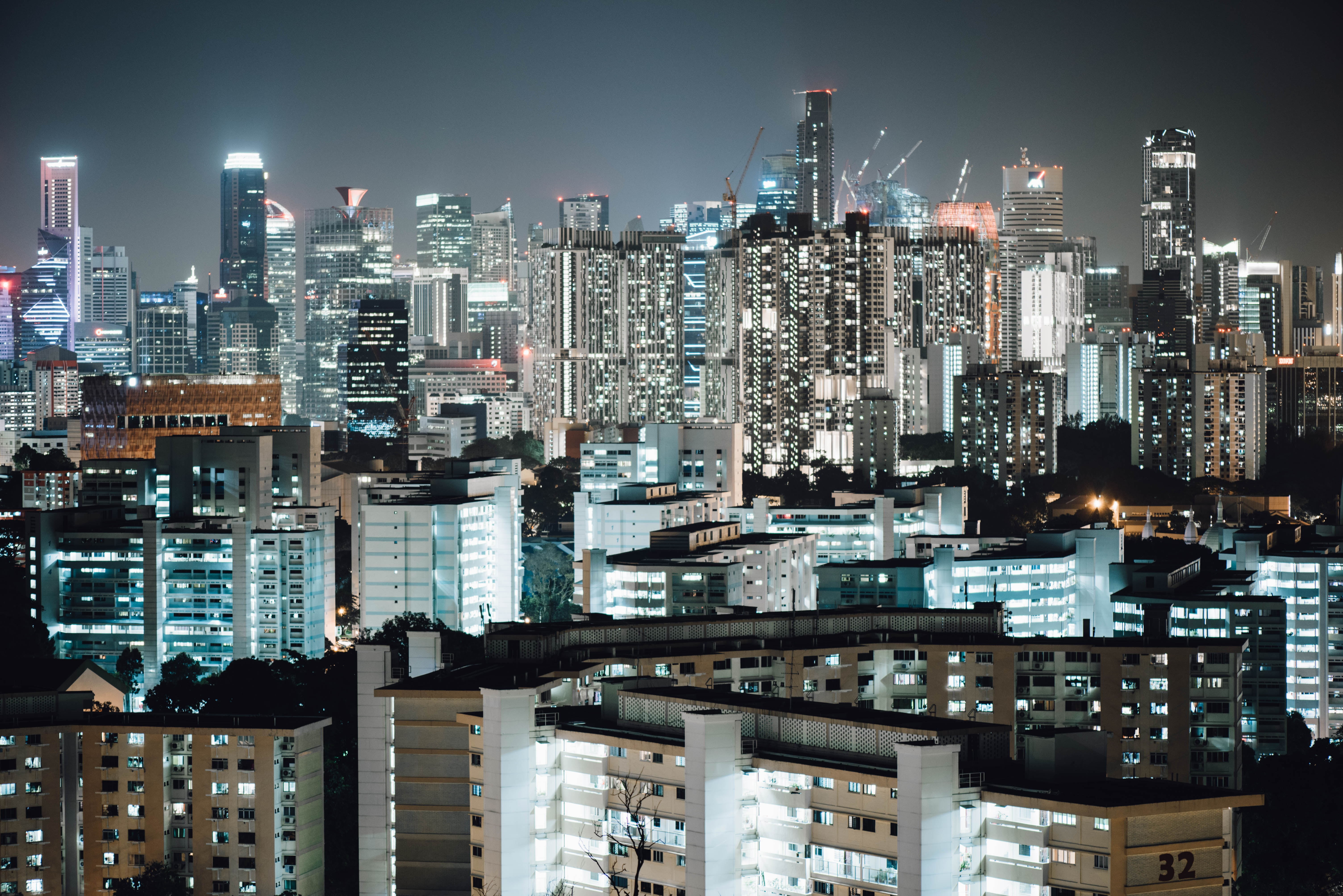 Bright lights in high-rises and skyscrapers in a city after dusk