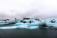 teal ice berg during daytime