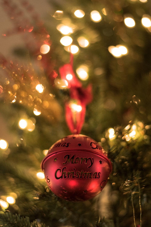 red Christmas bell on Christmas tree
