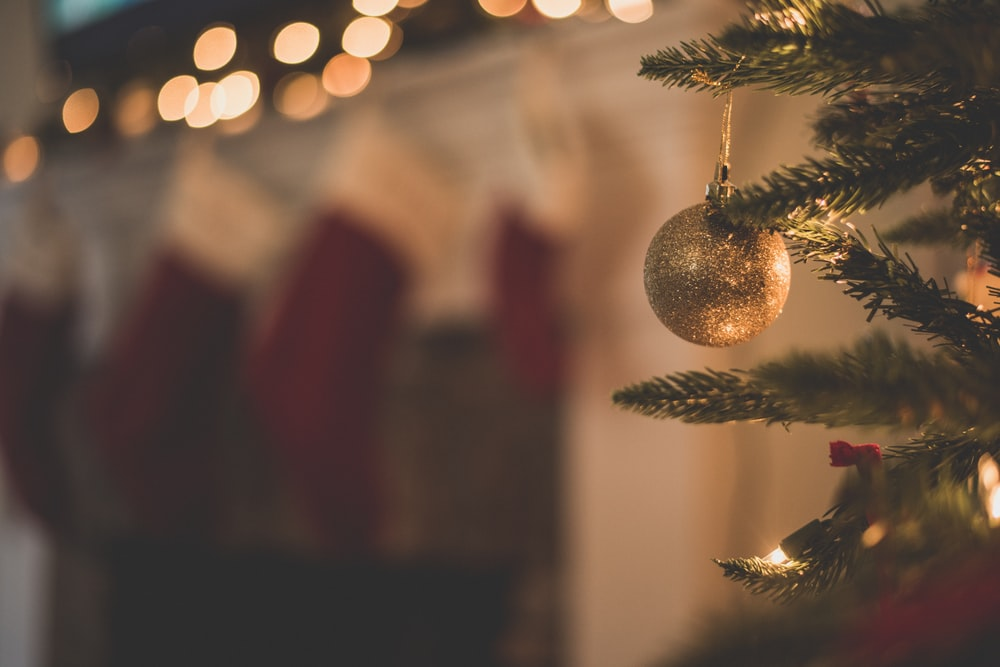closeup photo of baubles on christmas tree