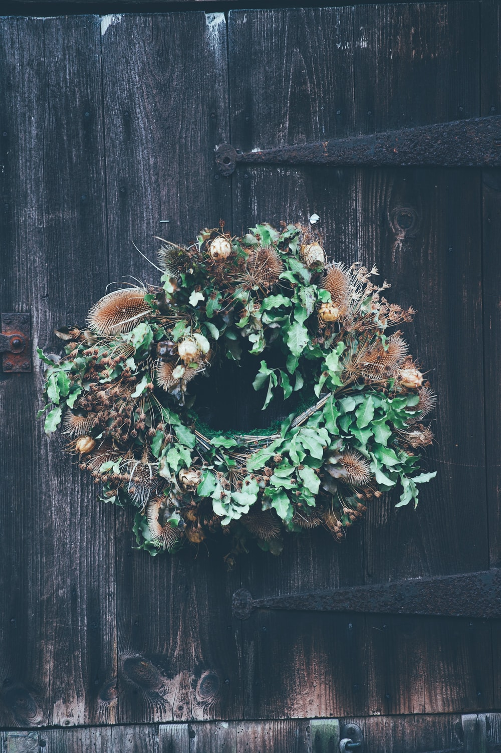hanging green and brown floral wreath