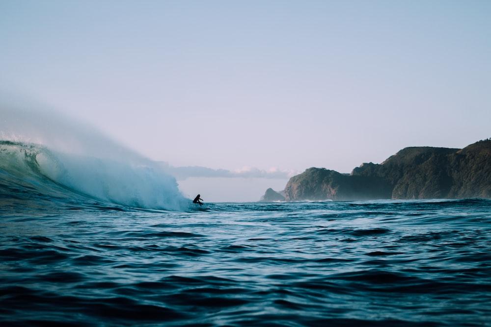 ocean near mountains during daytime