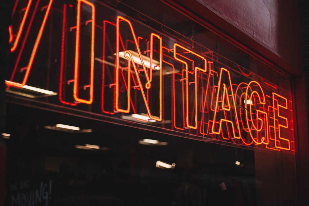red neon signage on glass wall