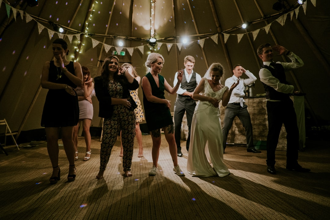 Full dance floor at a wedding reception.