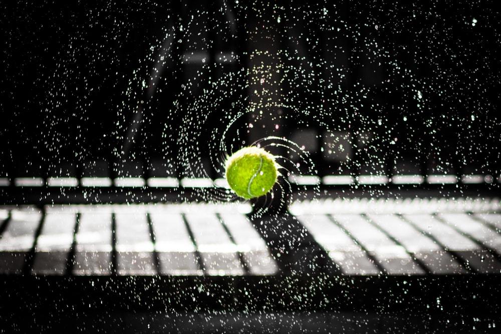 time lapse photo of tennis ball