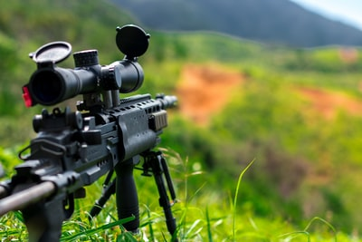 rules of third photography of sniper rifle army zoom background