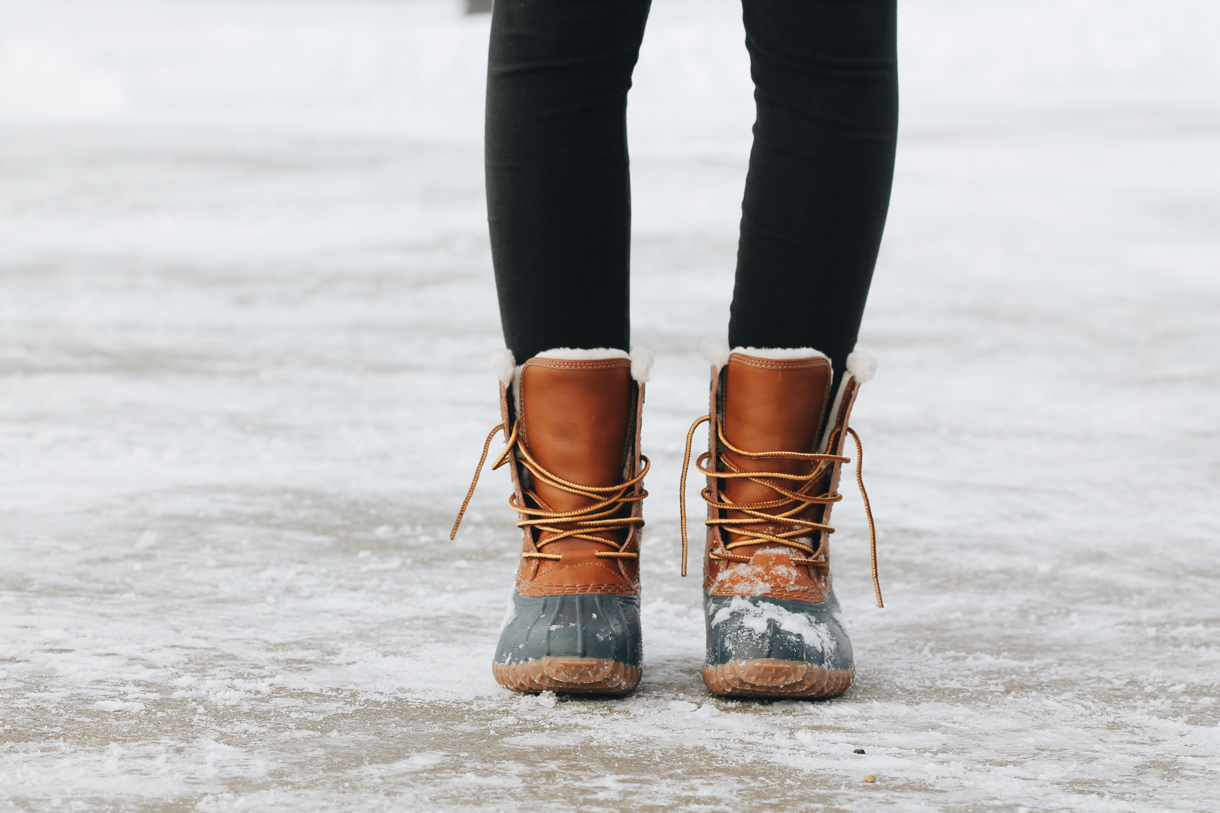 A close up shot of a woman wearing brown boots in Spirit Lake