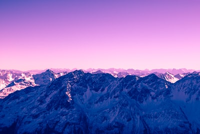 bird's eye photography of snow mountains violet teams background
