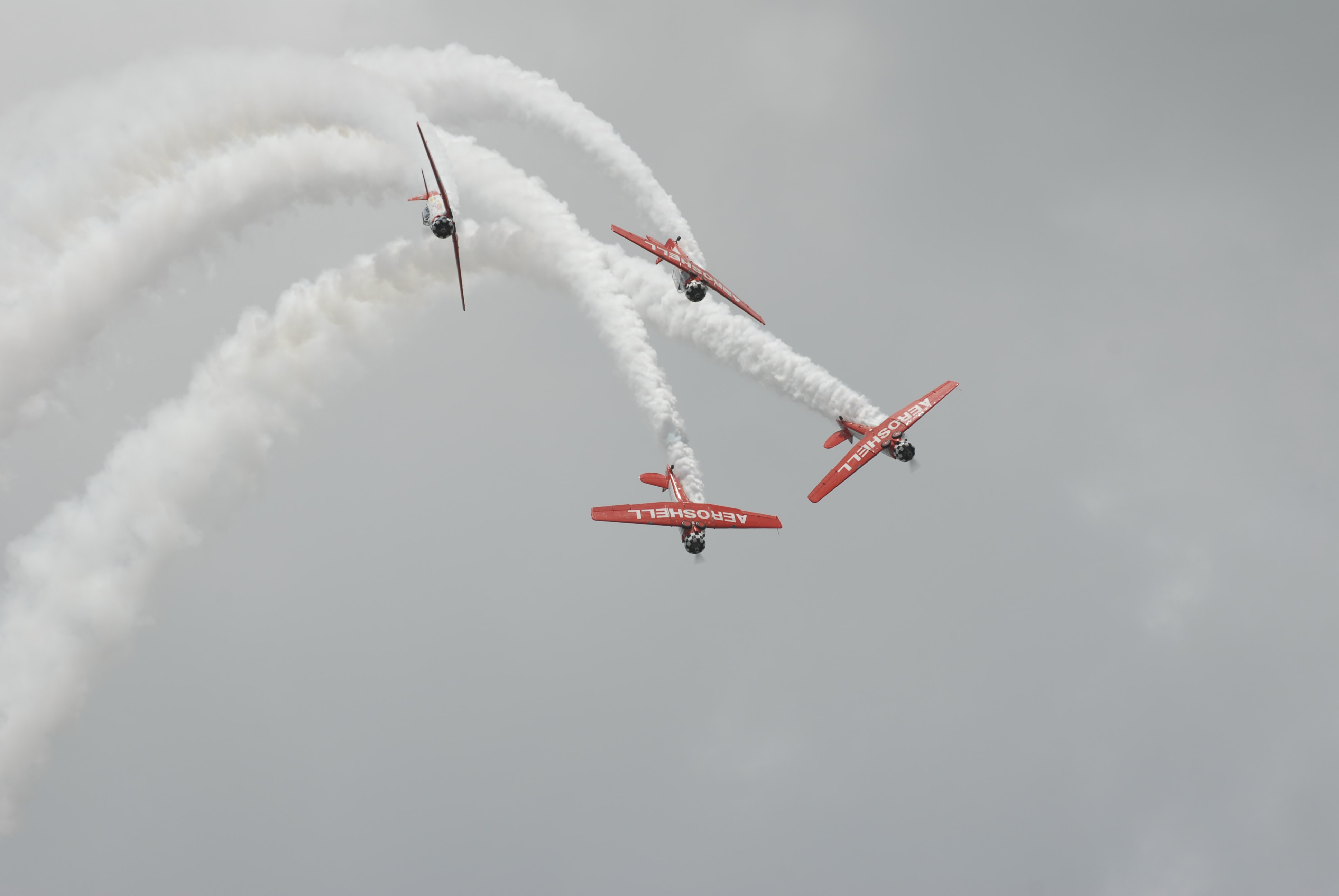 four red biplanes air exhibition