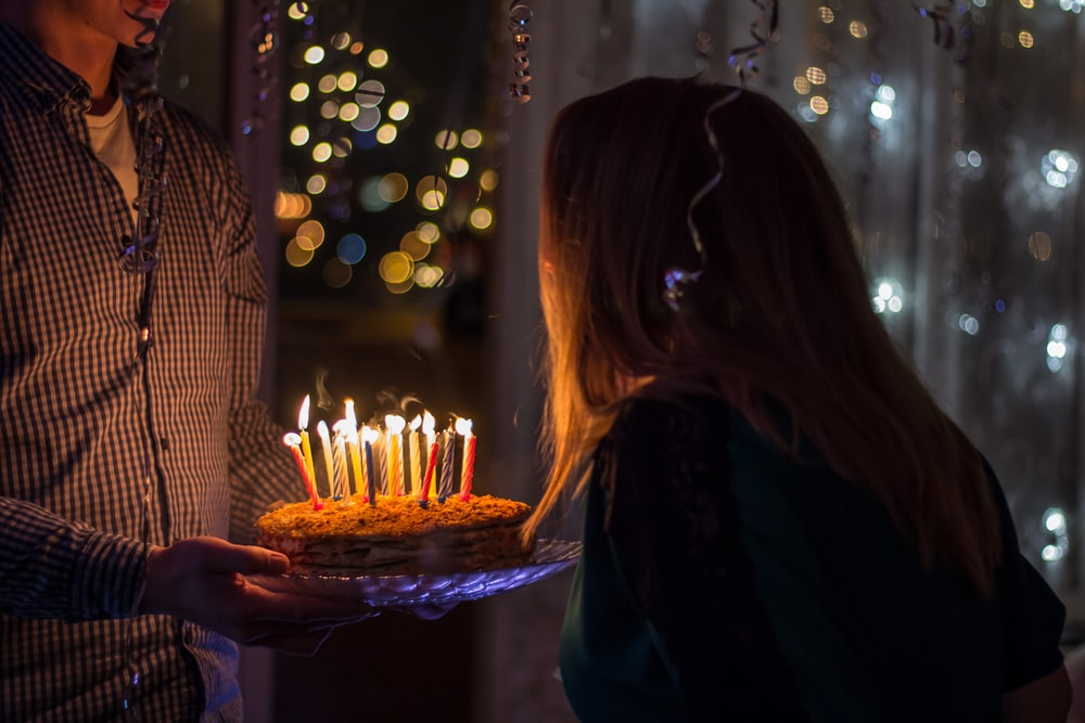 photo of birthday birth about to blow birthday candles