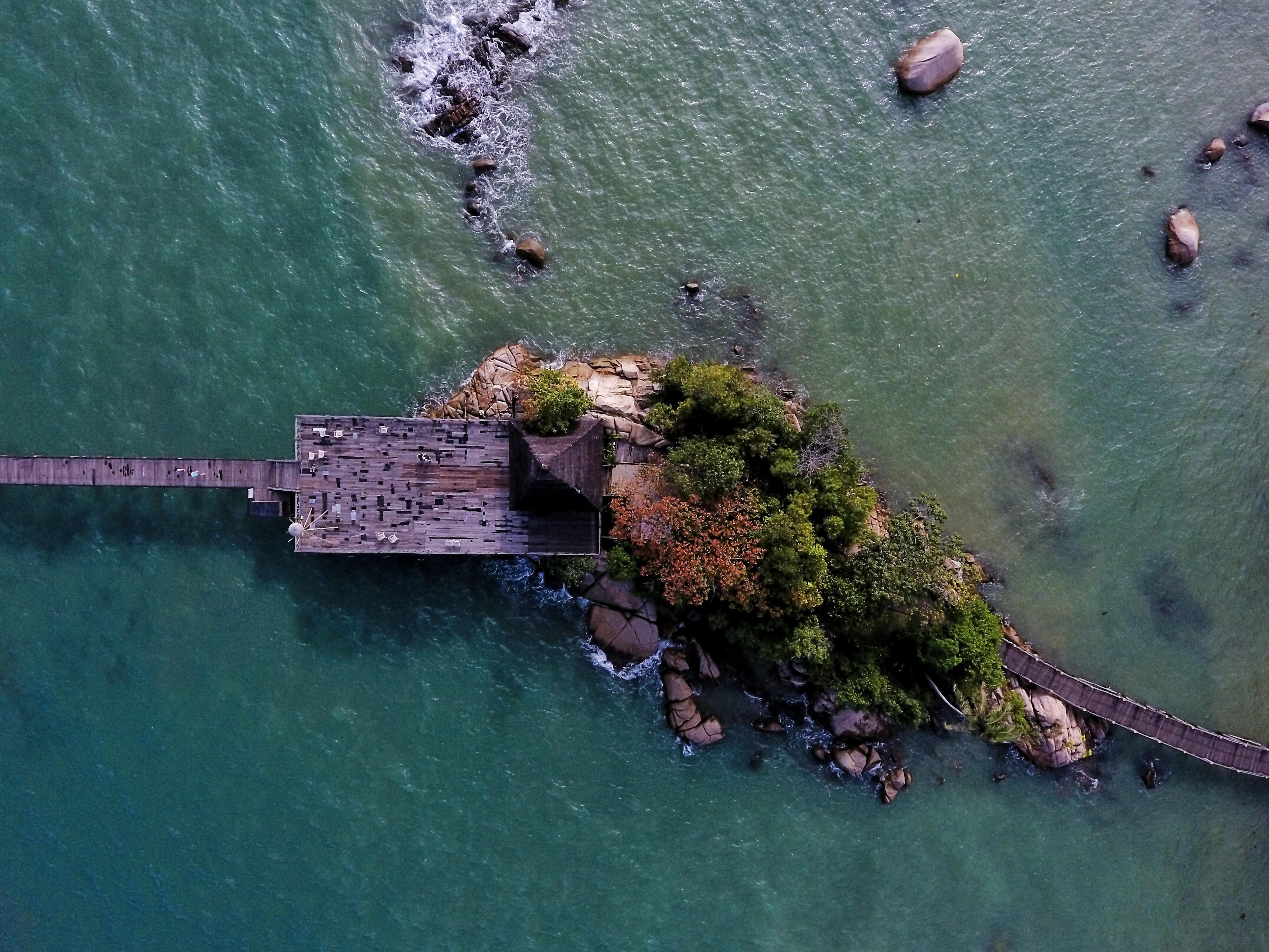 high angle photography of island with sea