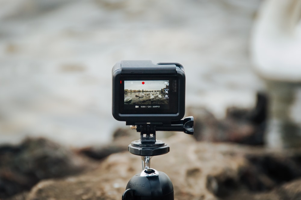 black action camera on tripod