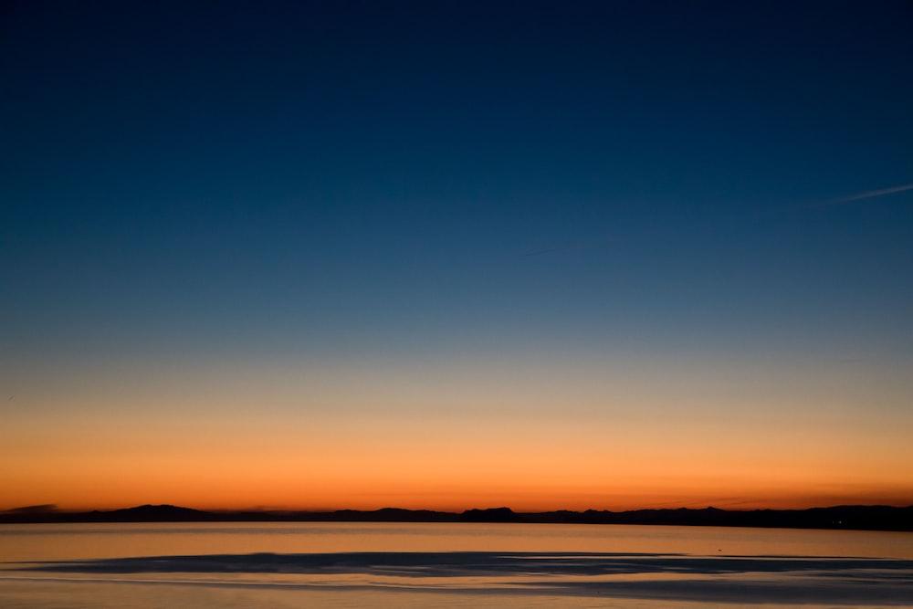 landscape photo of seashore during golden hour