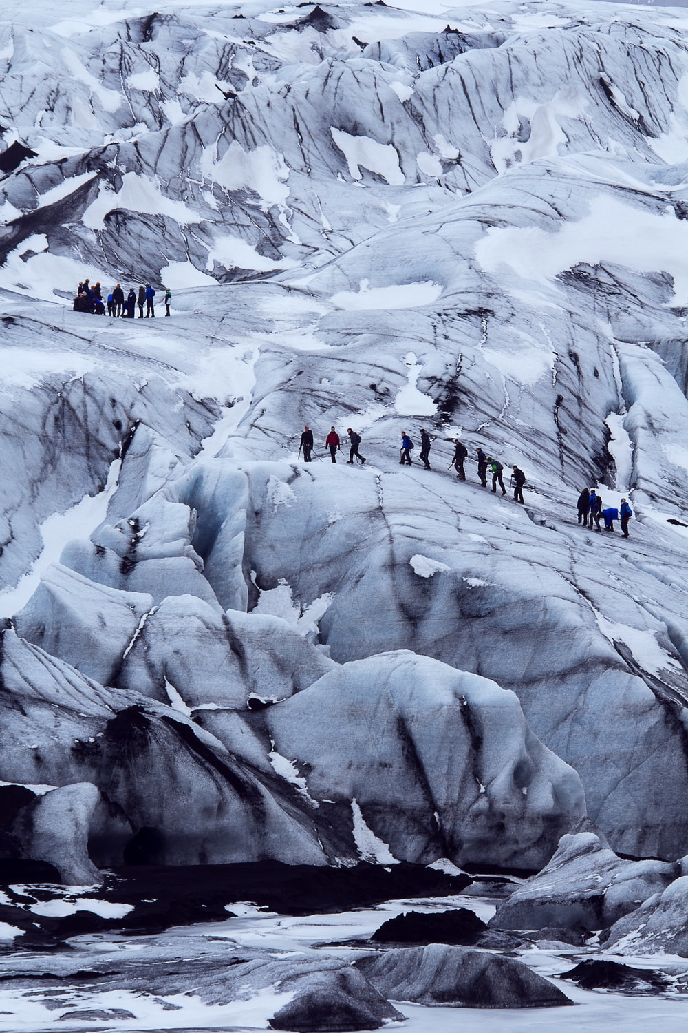 people on snow covered mountain