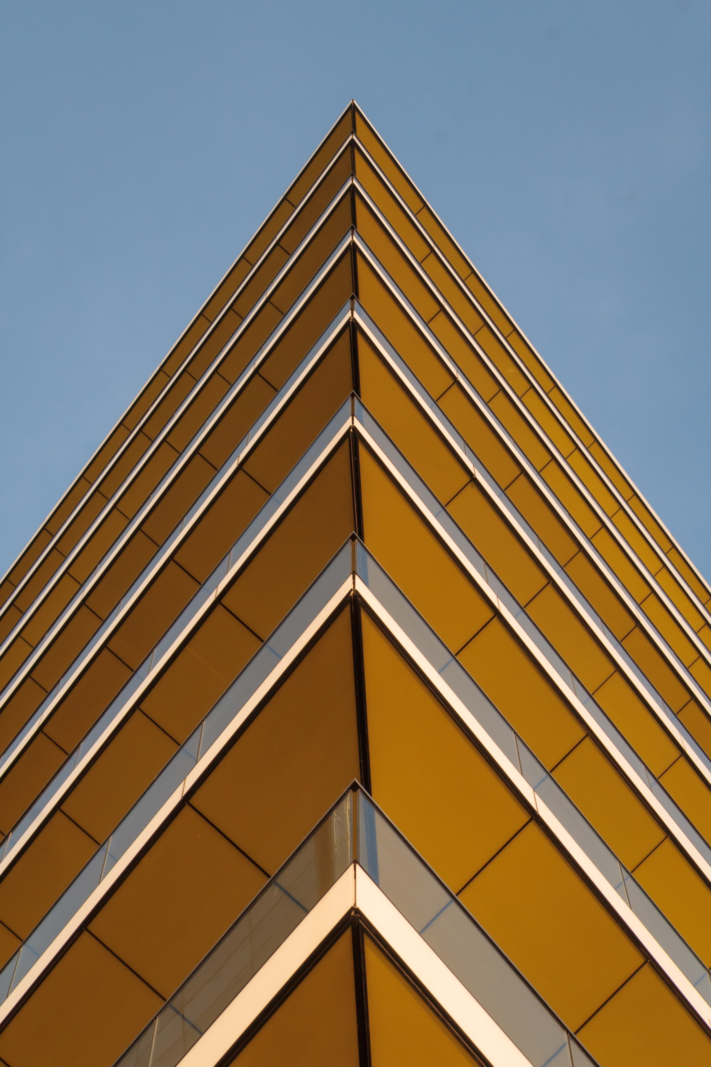 worm's-eye view photography of yellow building