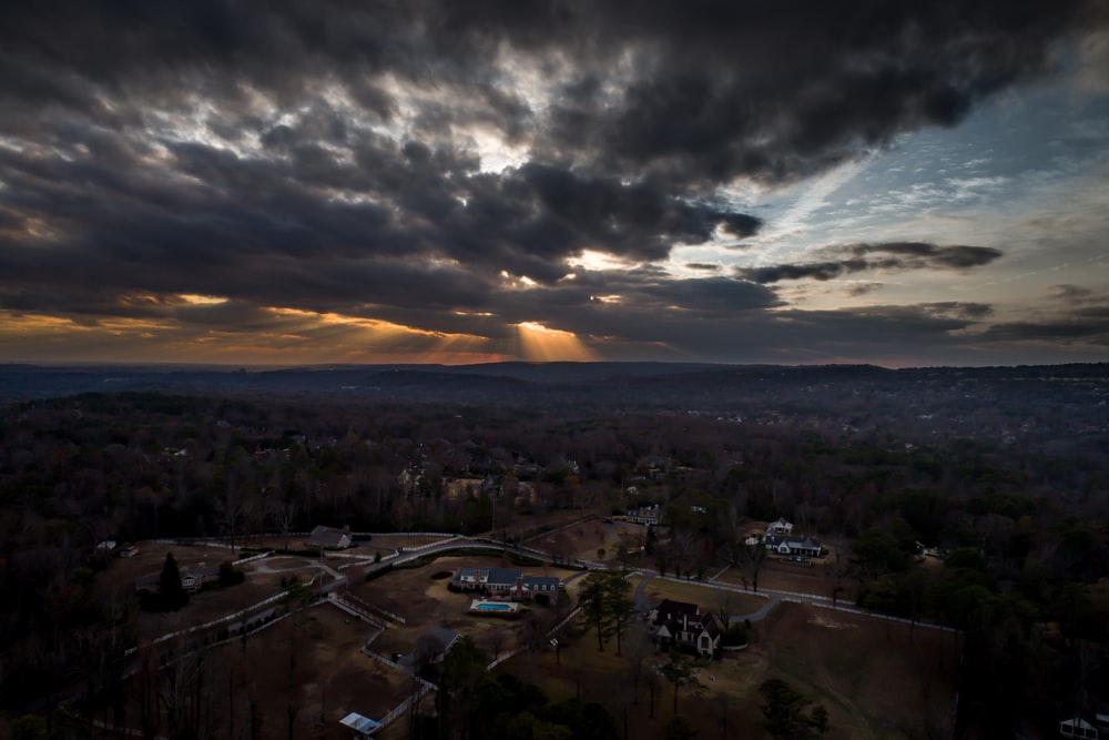 aerial view of rural area under dark clouds