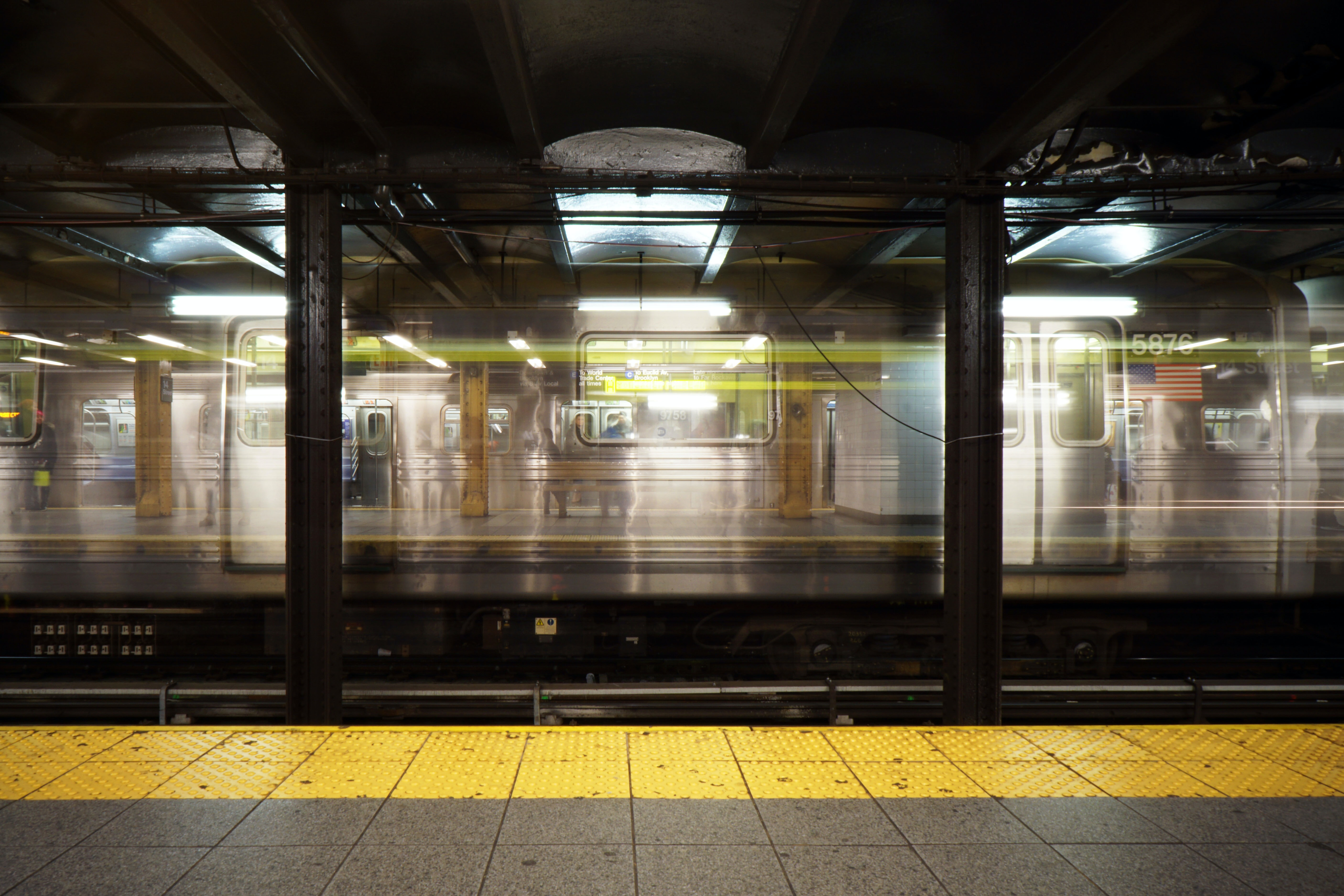 A double-exposure shot of a New York train arriving at a station