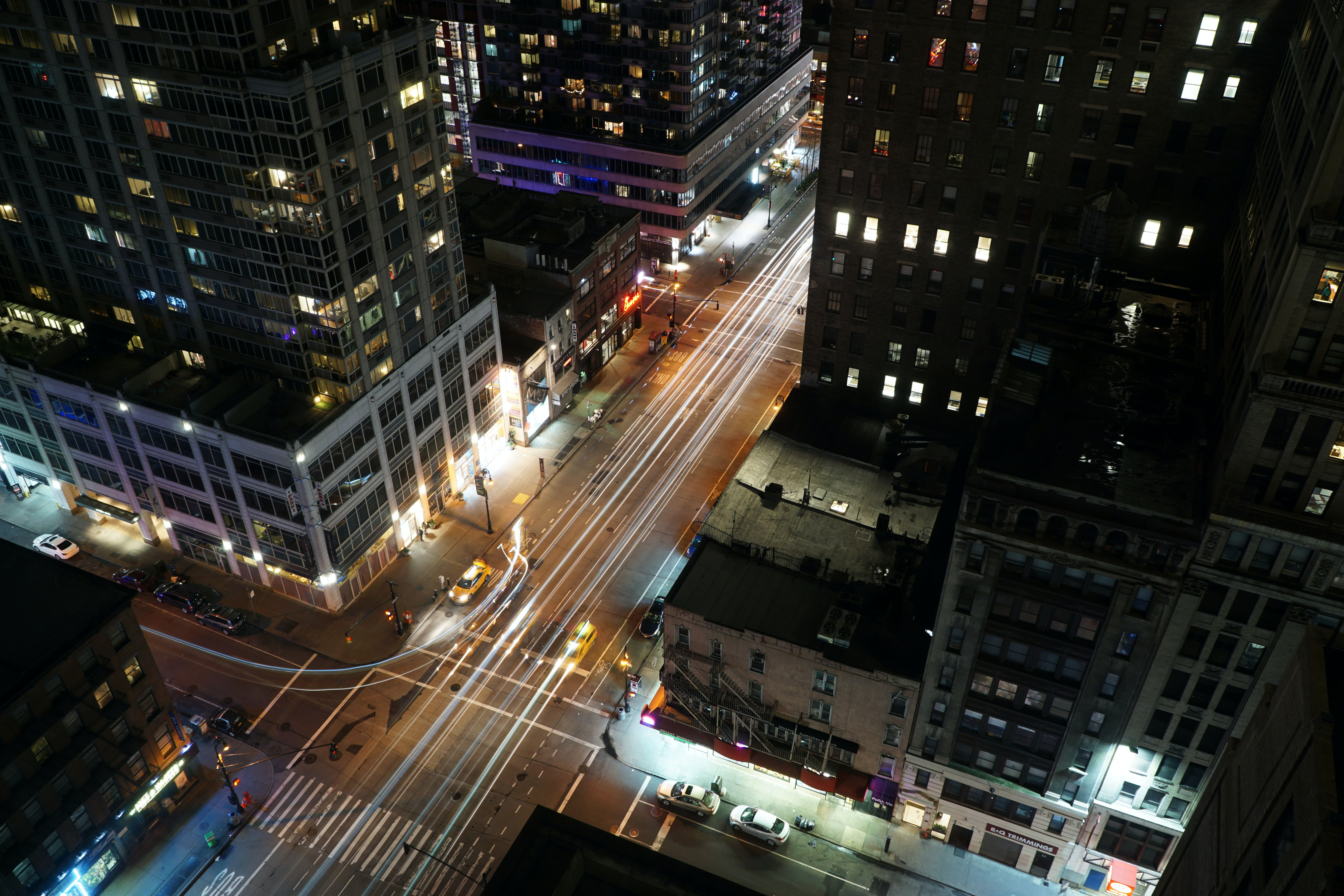 timelapse photograph of street and concrete structures