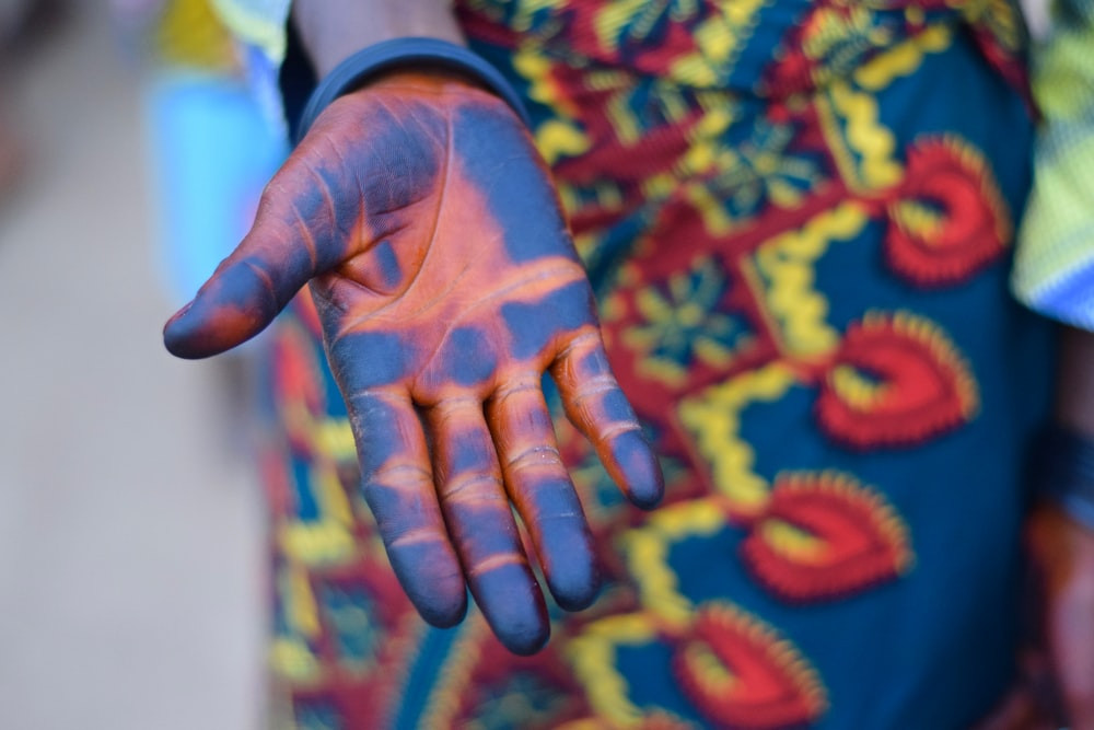 person's blue hand paint