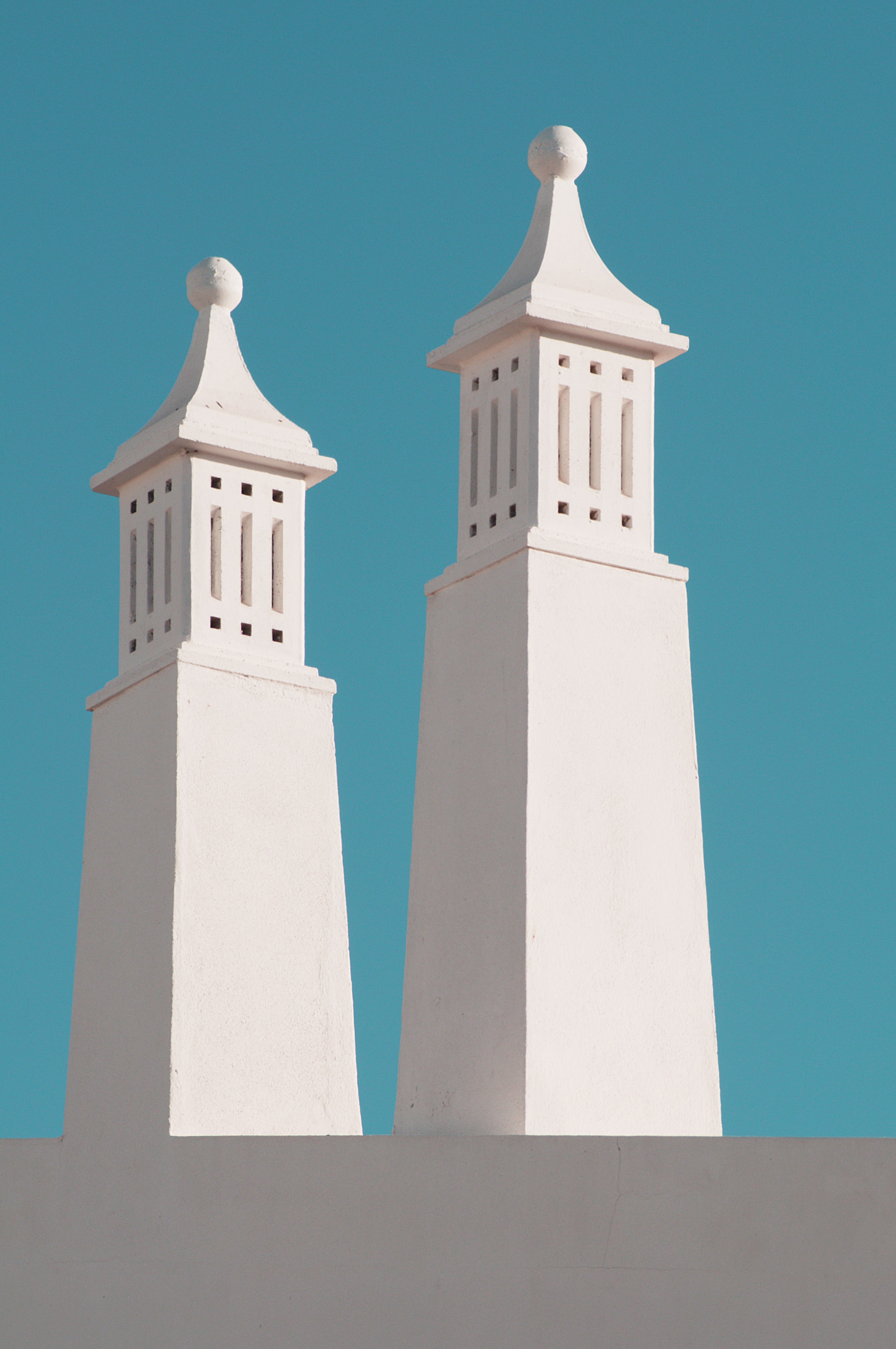 White concrete spires against a blue sky