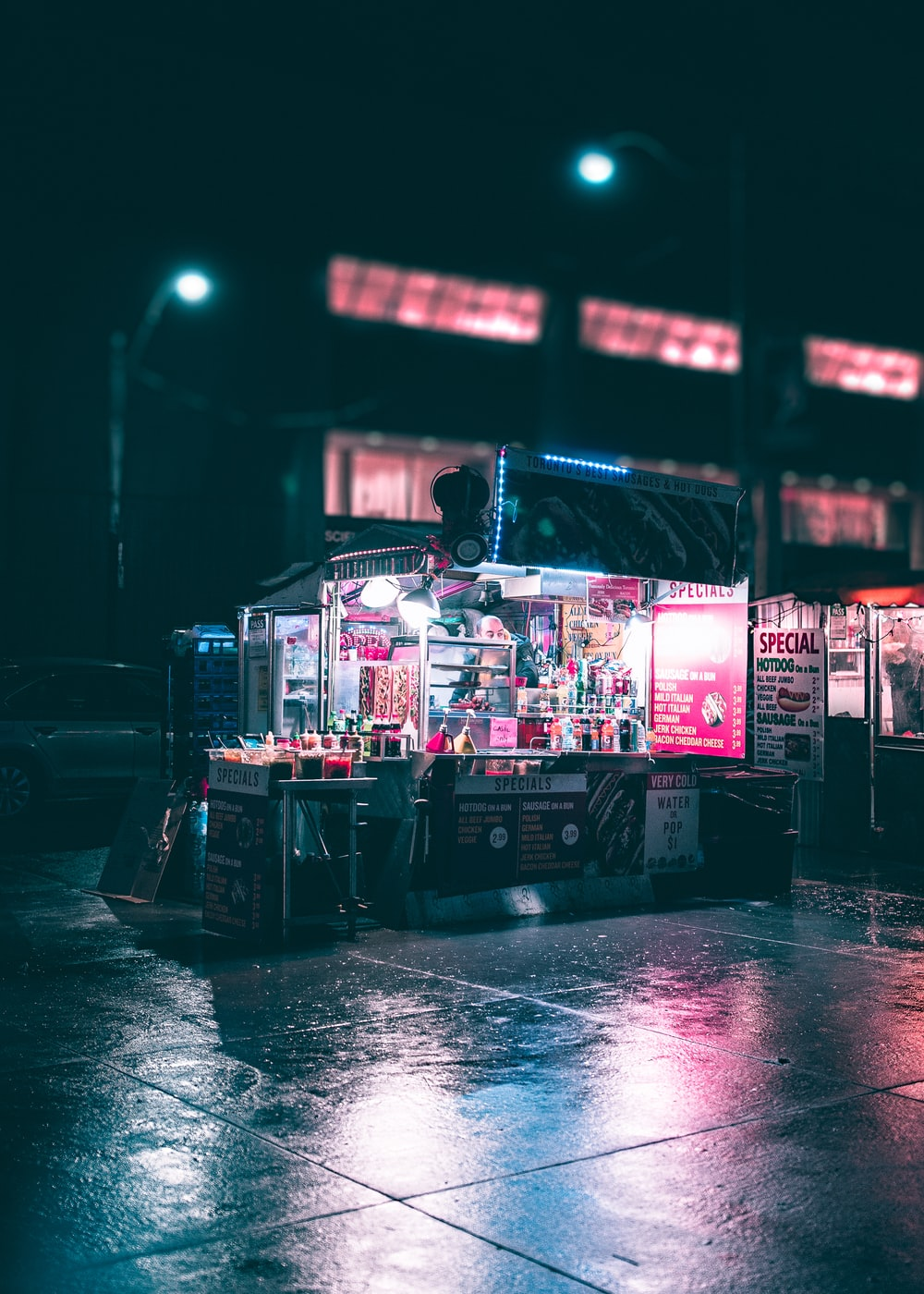 black and gray food stand during nighttime