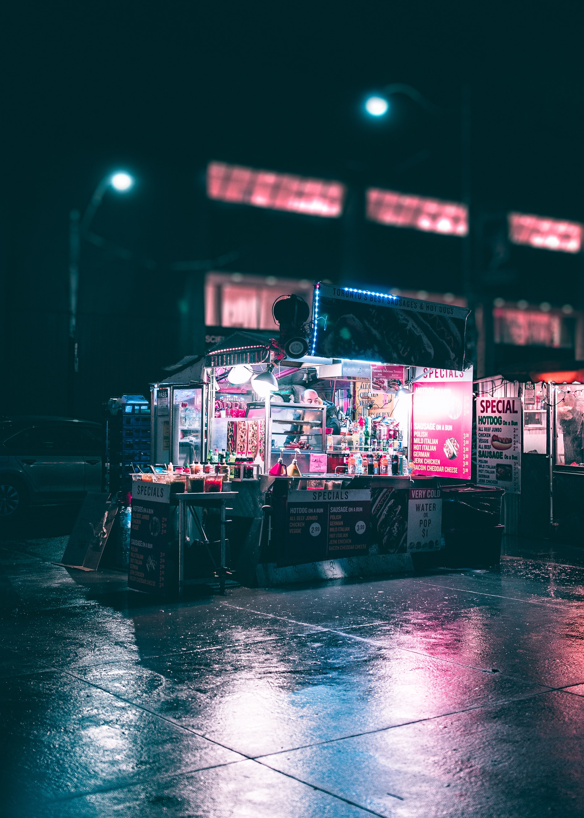 Urban hotdog vendor open and a late night in the city