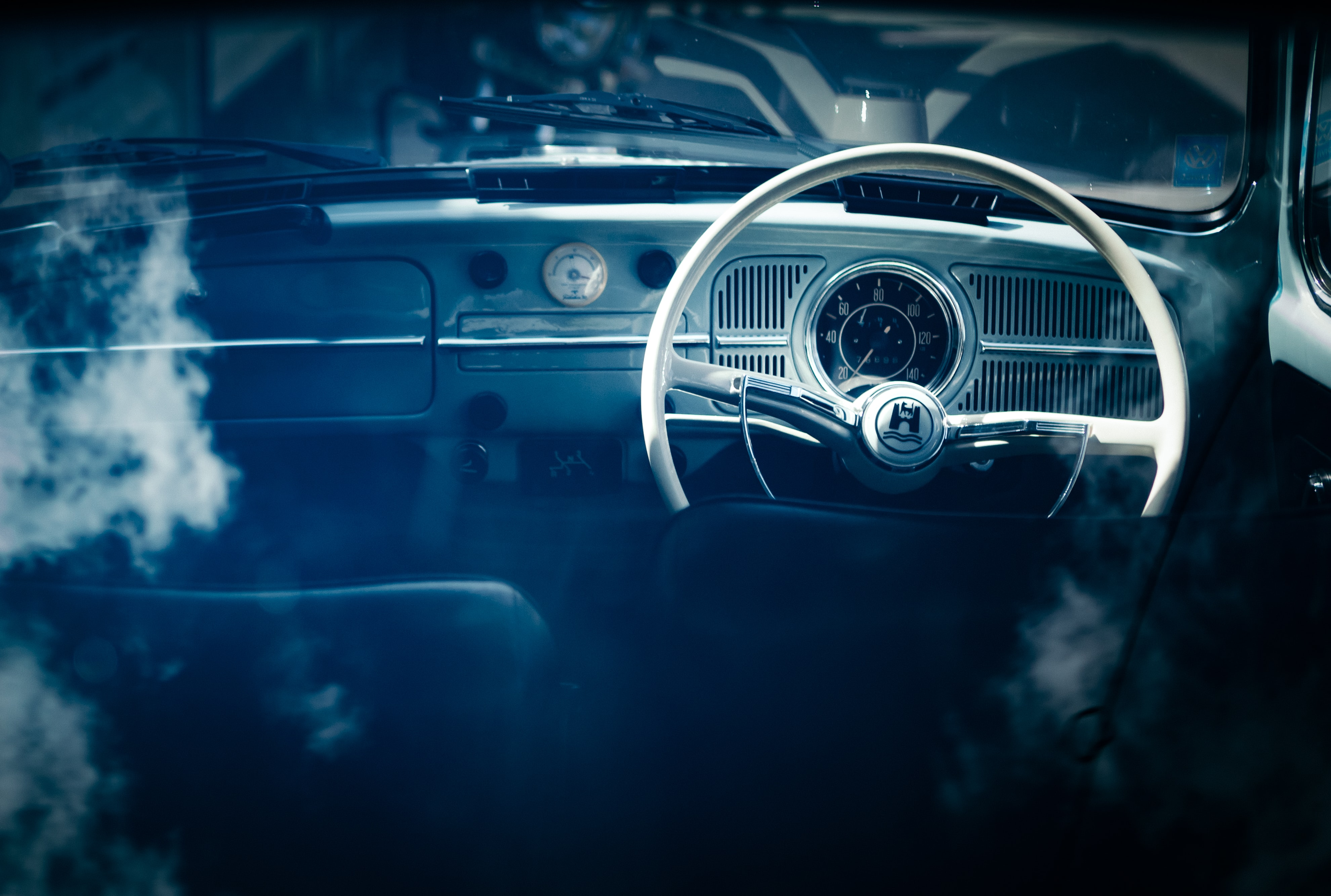 Dashboard and steering wheel of a vintage car in Kochi.