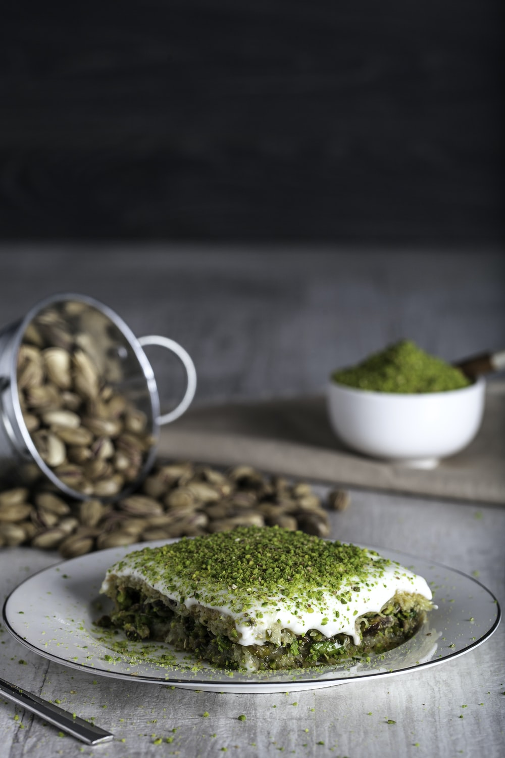Pistachio Kadayif on white ceramic plate