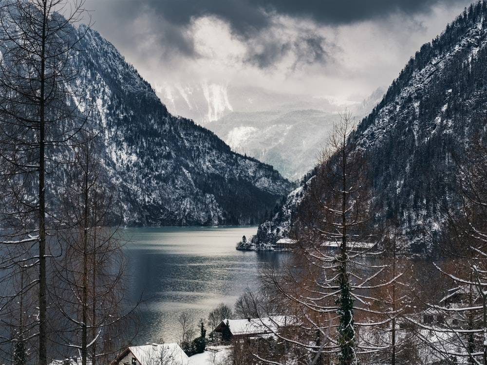 body of water surrounded with mountains