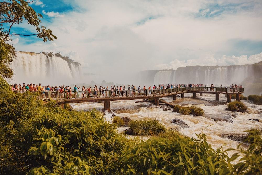 landscape photo of people on bridge