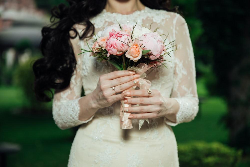 woman wearing white lace long-sleeved wedding dress