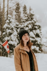 woman standing on snow covered place
