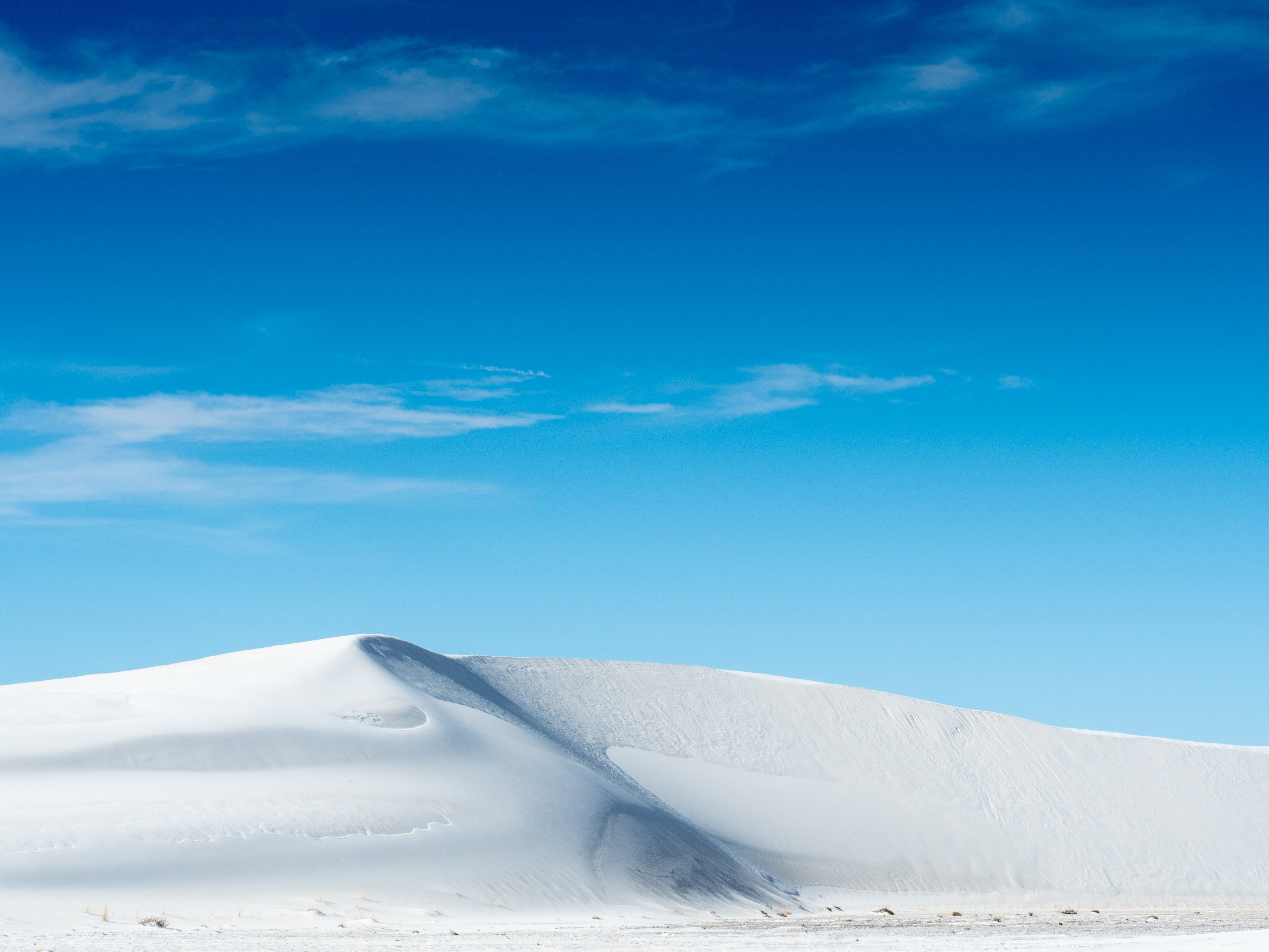 White dunes under the blue sky at White Sands National Monument.