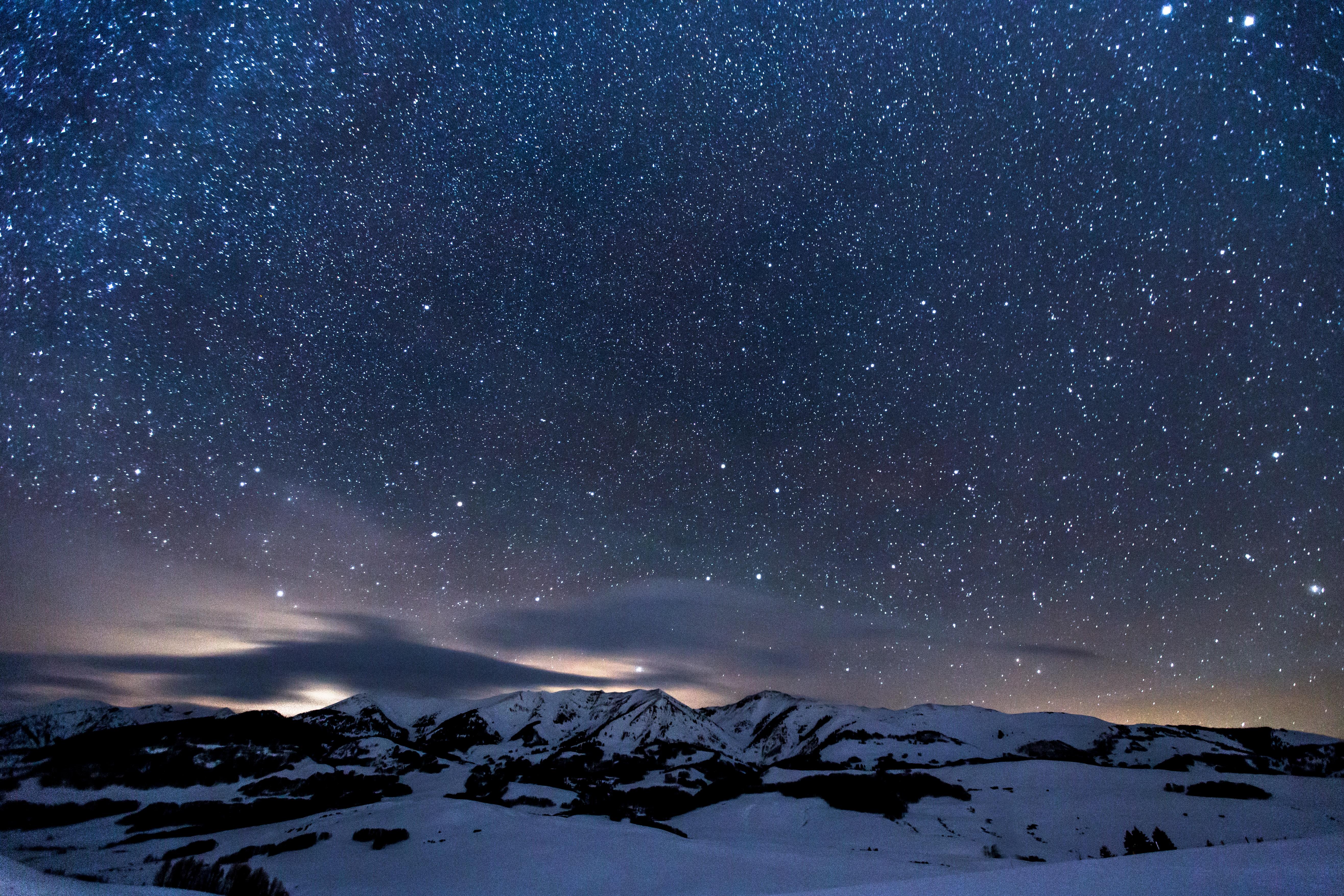 night sky with stars above snow landscape