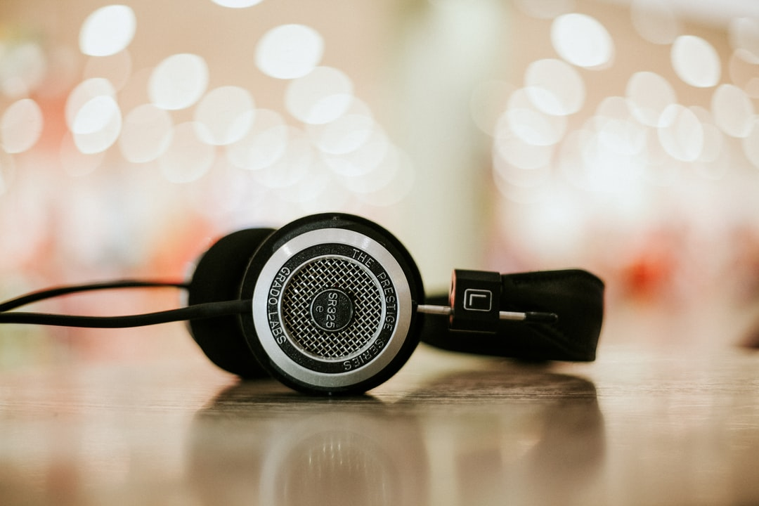 A close-up of headphones on a flat surface with bokeh effect in the background