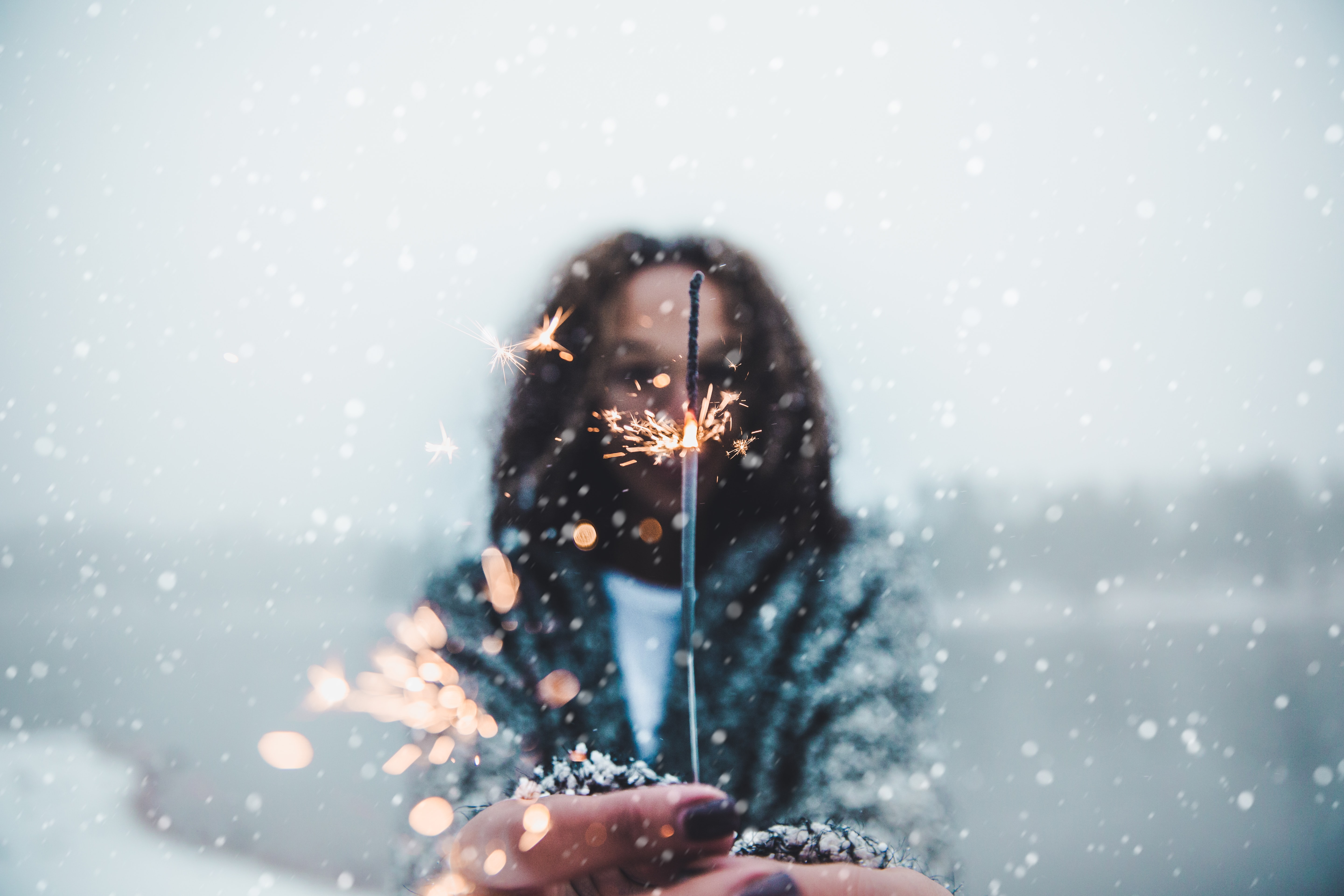 woman holding sparkler bokeh light