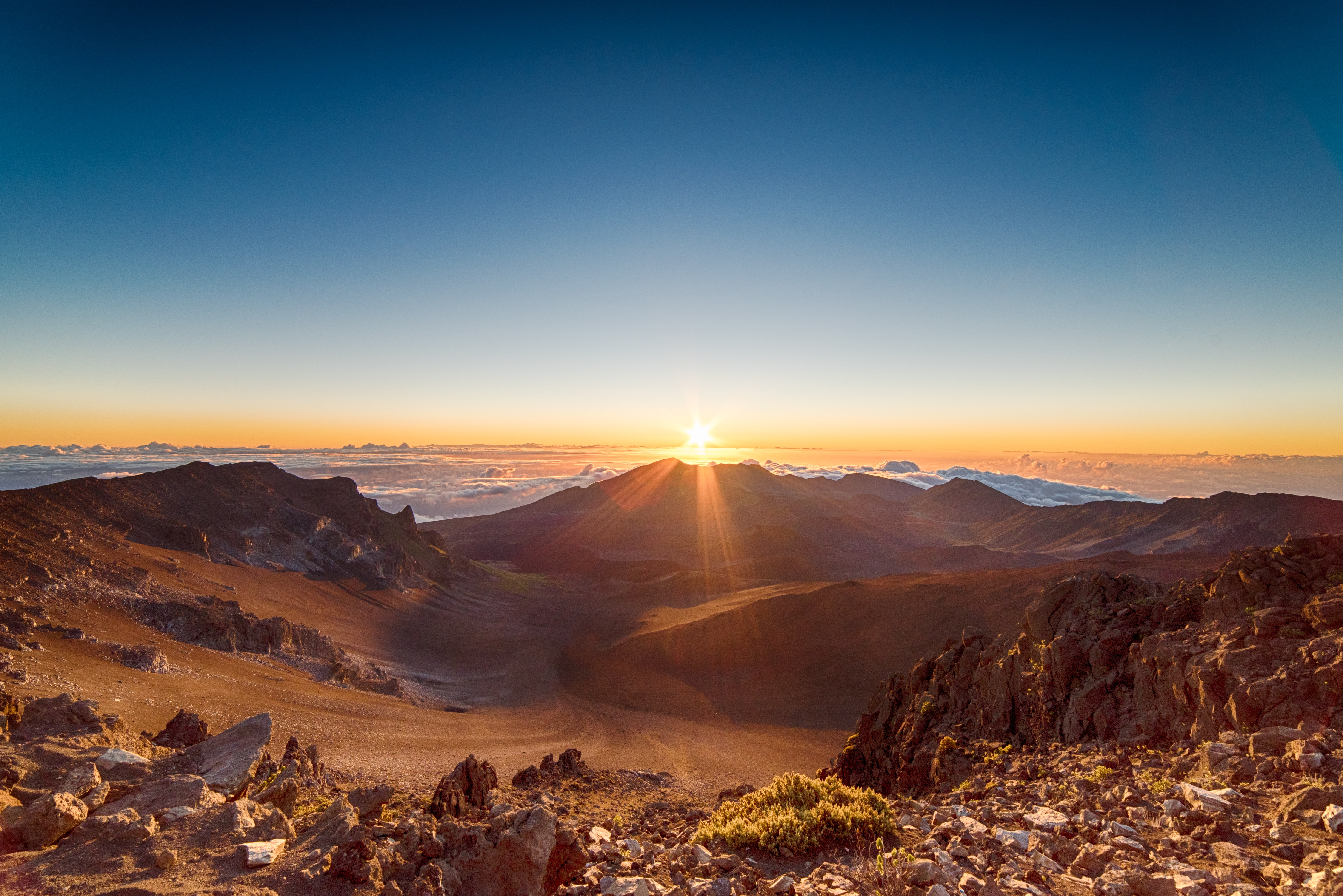 brown mountains during sunrise