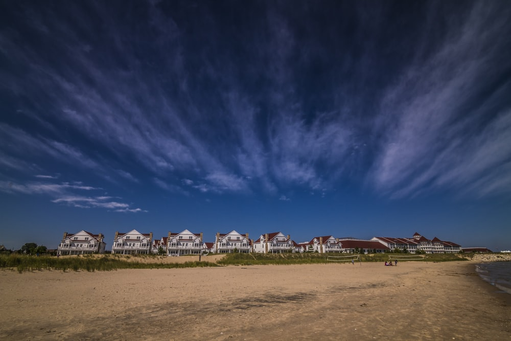 landscape photography of house under white clouds