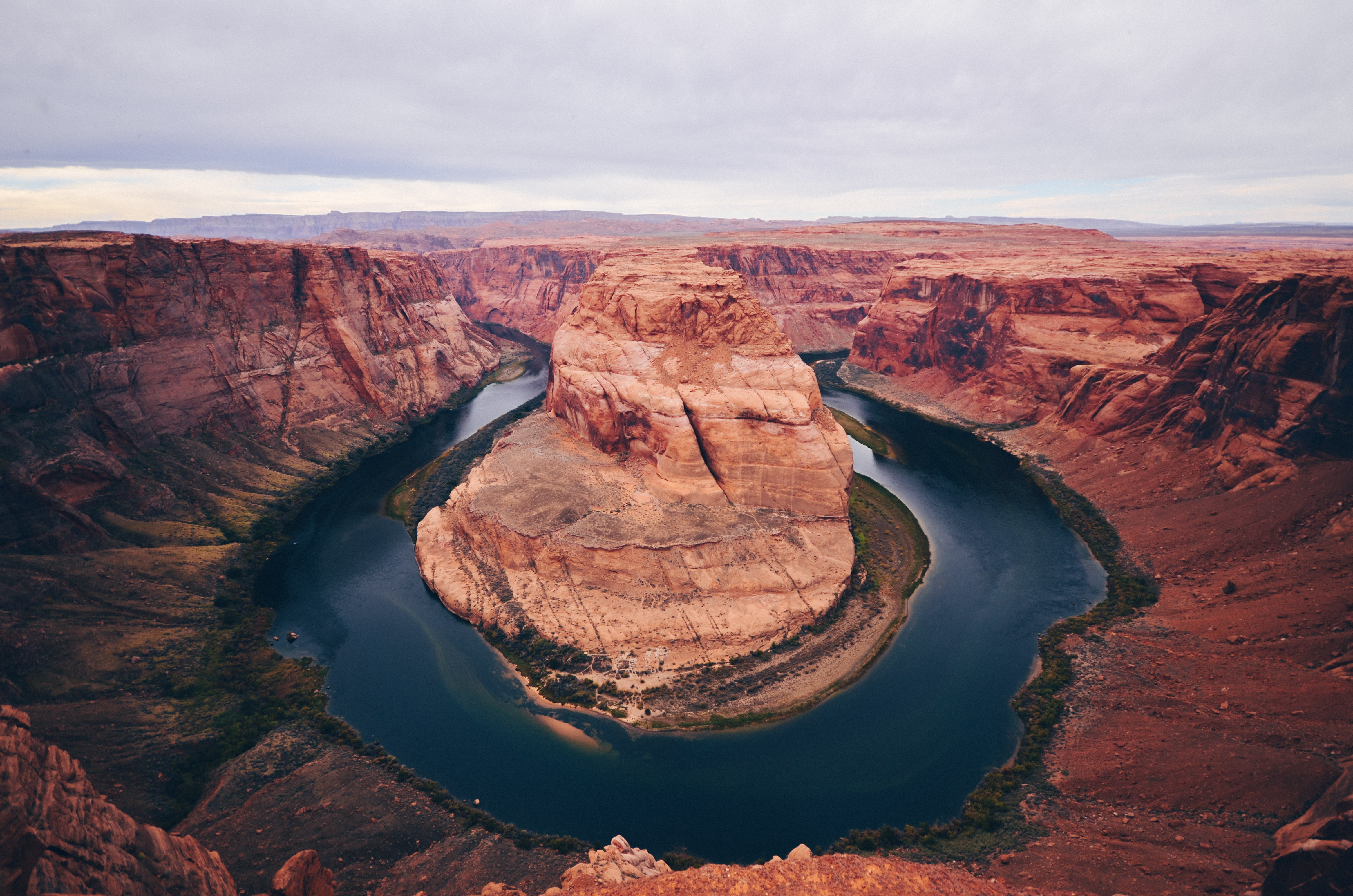 Panoramic shot of the famous Horseshoe Bend and surrounding canyons.