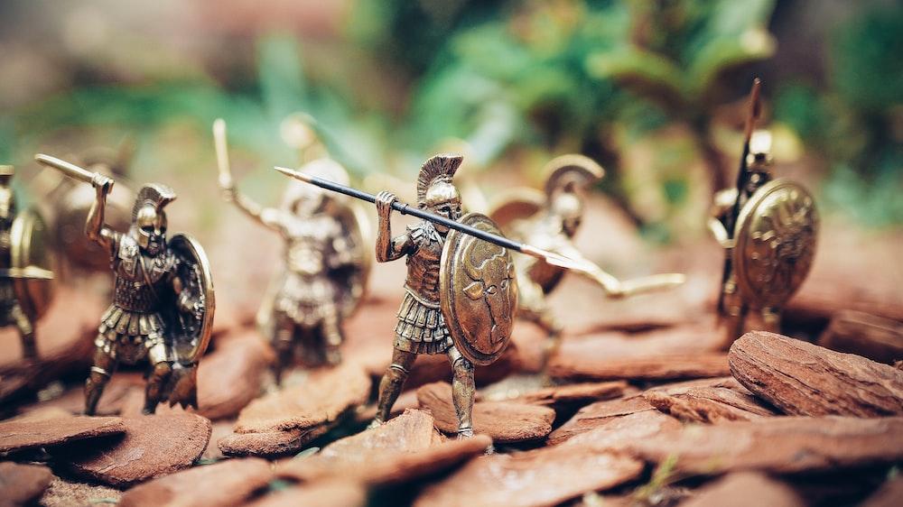 grey metal knights figurines during daytime