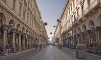 people walking between buildings during daytime