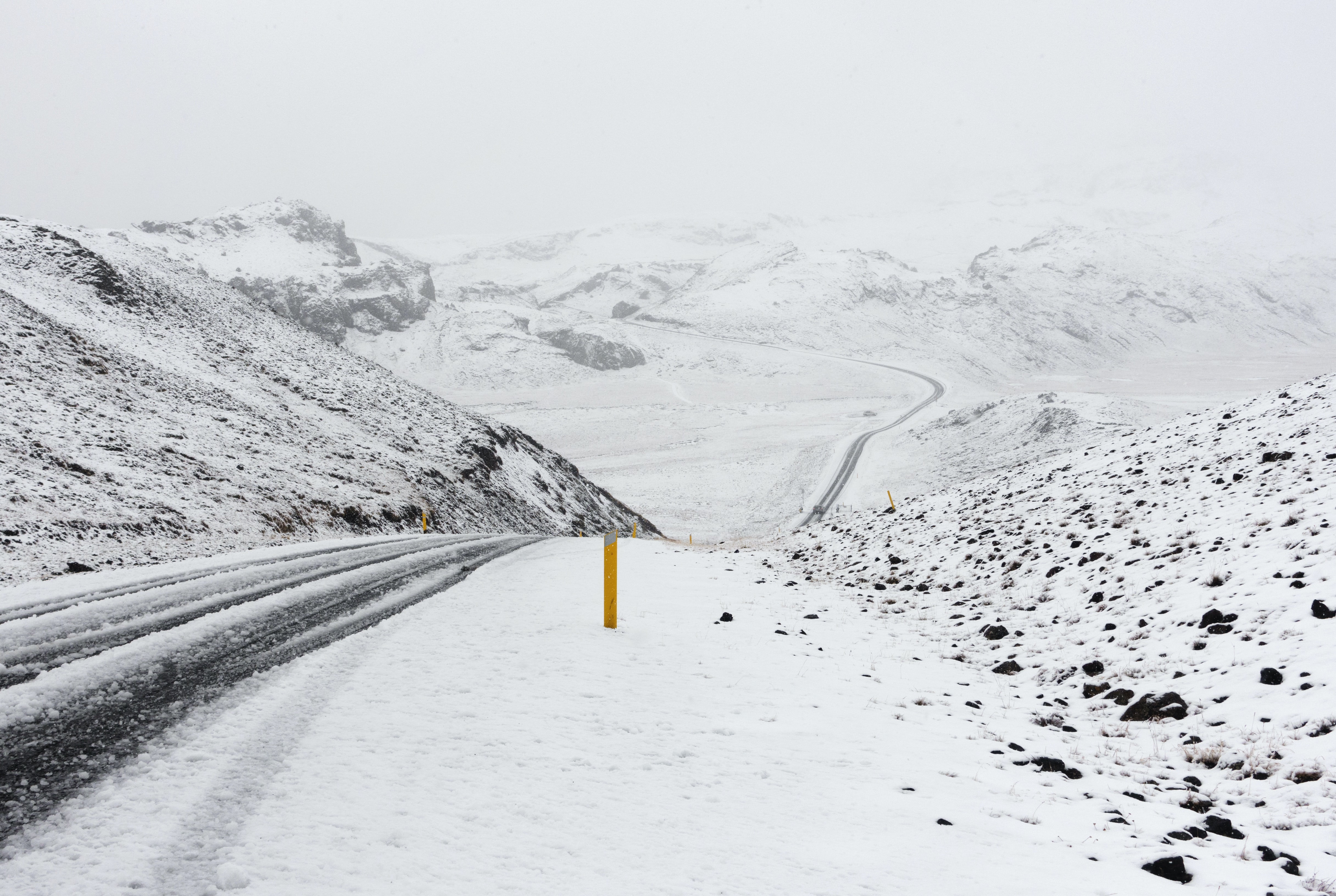 A hilled route along frozen mountaintops in Iceland