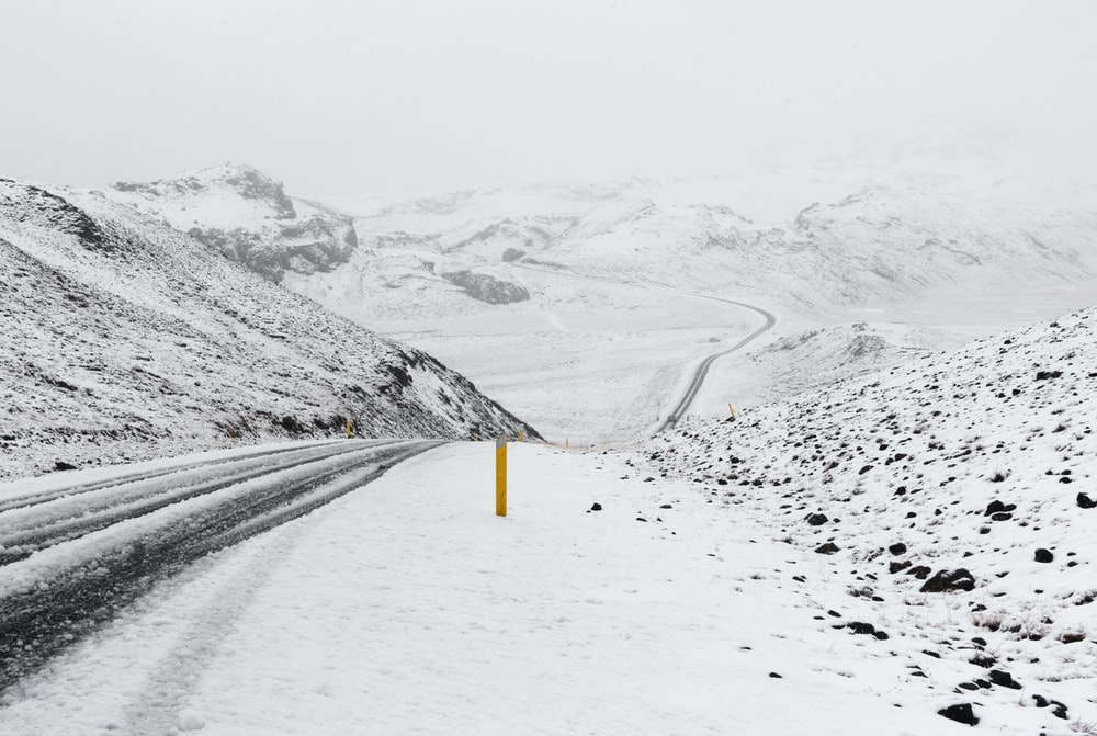 photography of snow covered road