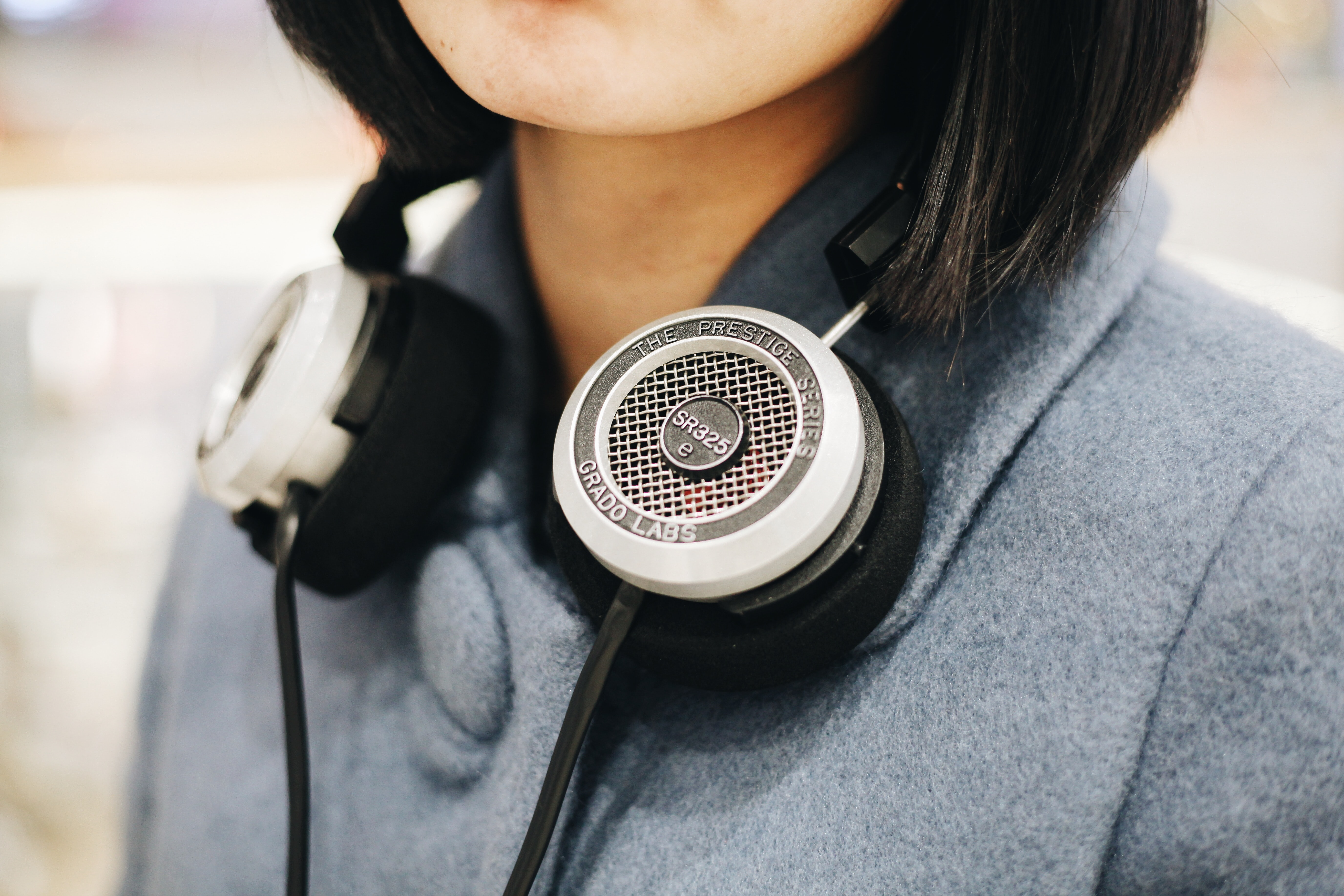 woman with black headphones around her neck