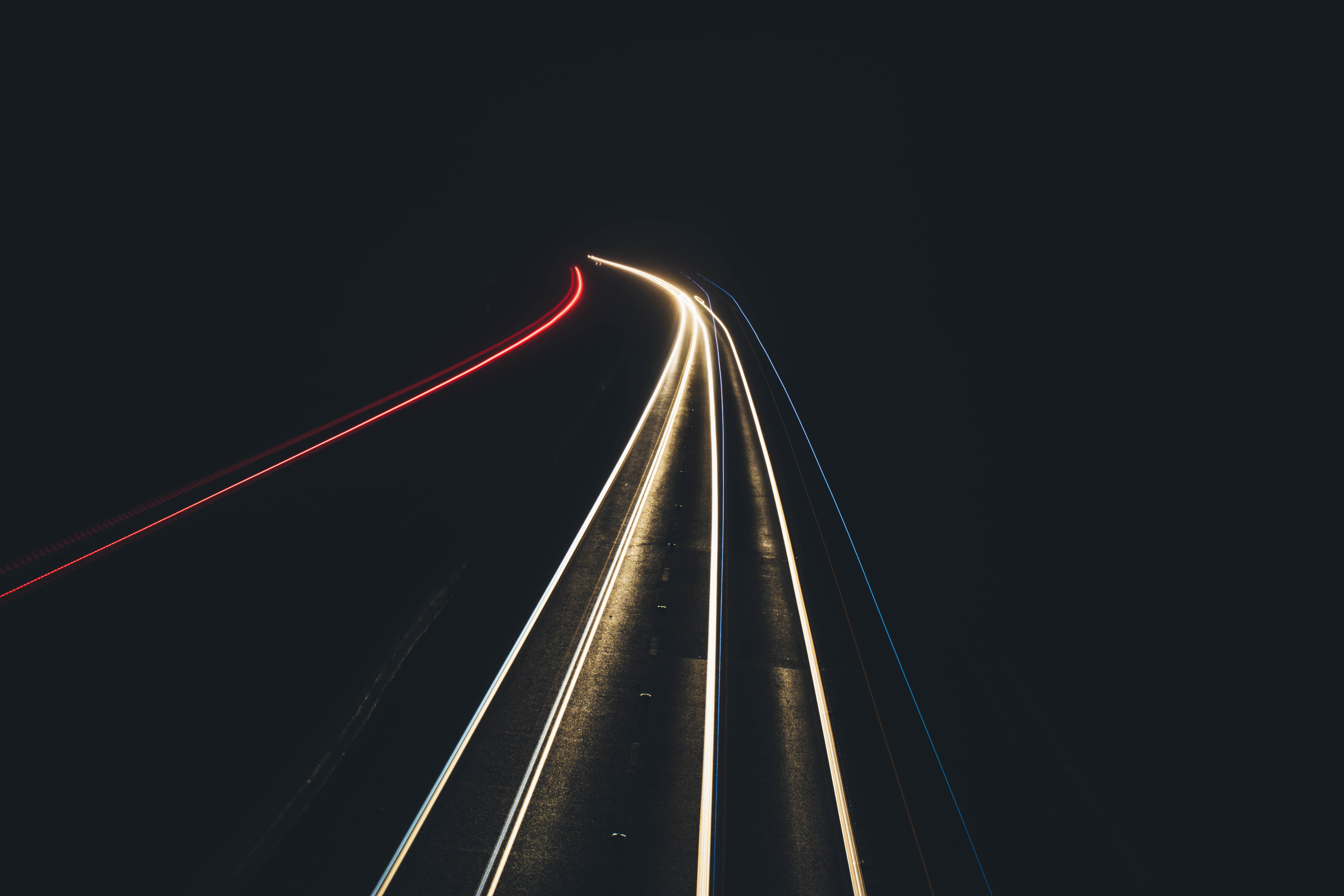 A long exposure shot of car lights glowing on a pitch black road in Scunthorpe