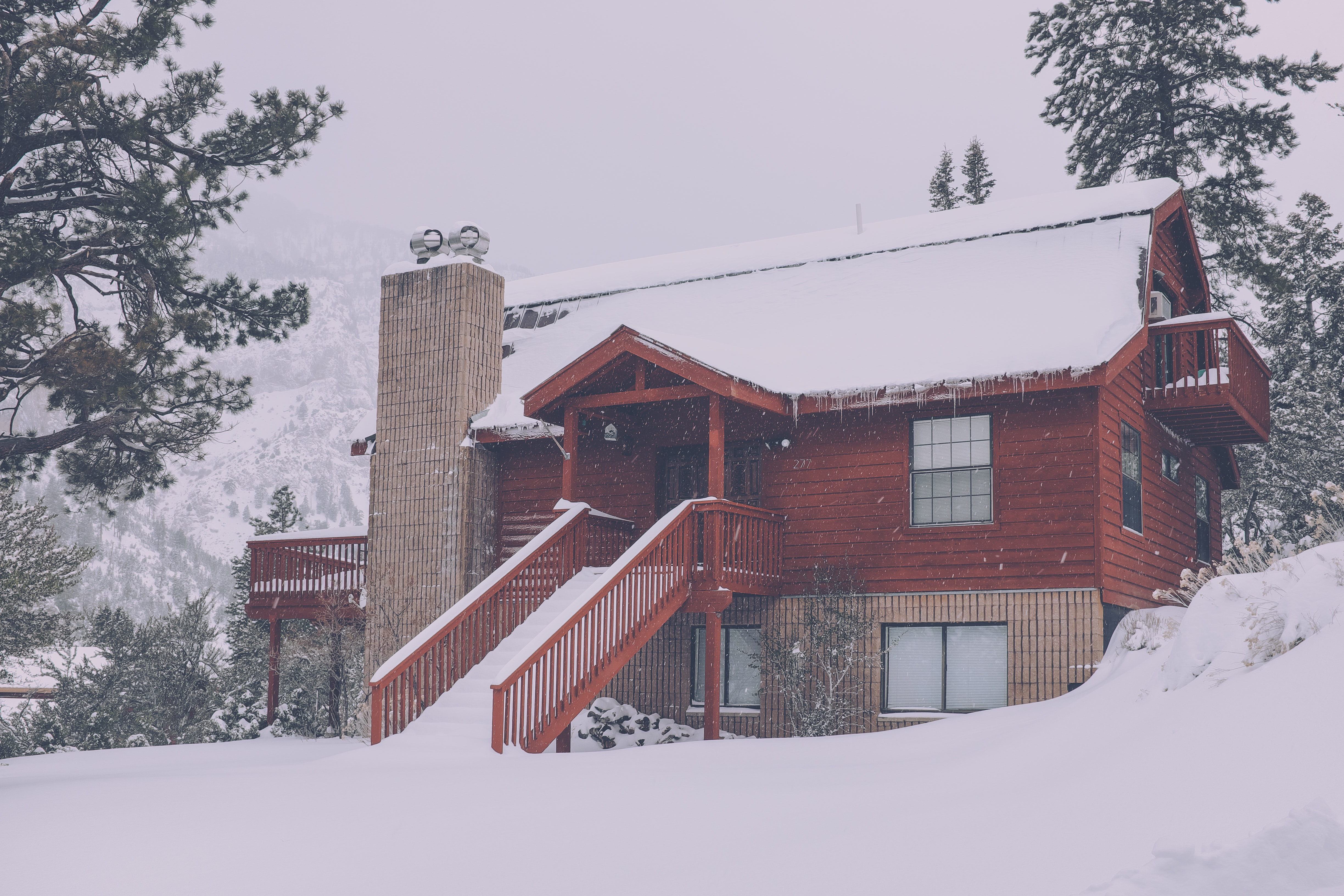 brown 2-storey house covered with snow