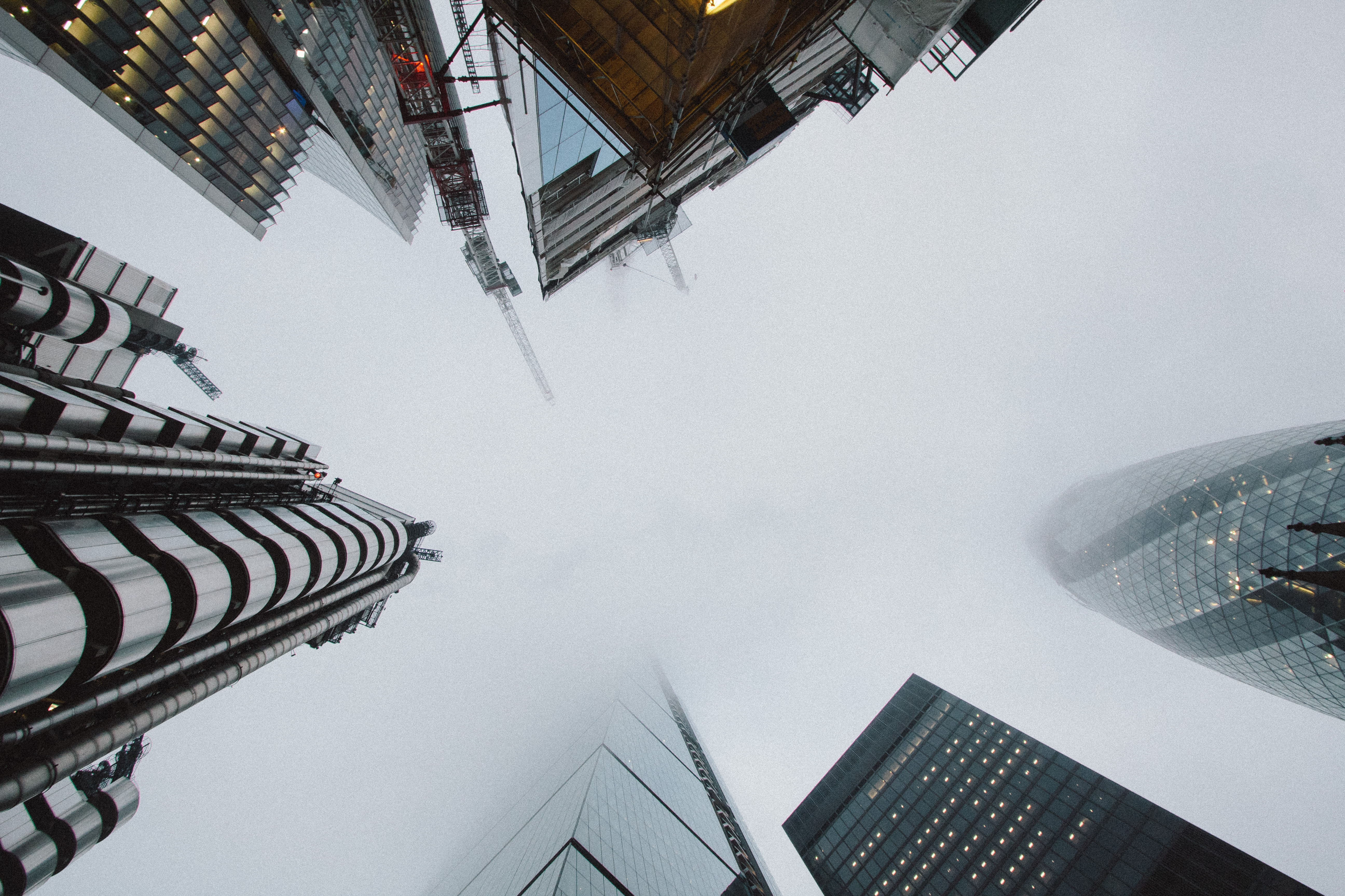 low angle photo of high rise building covered with fog