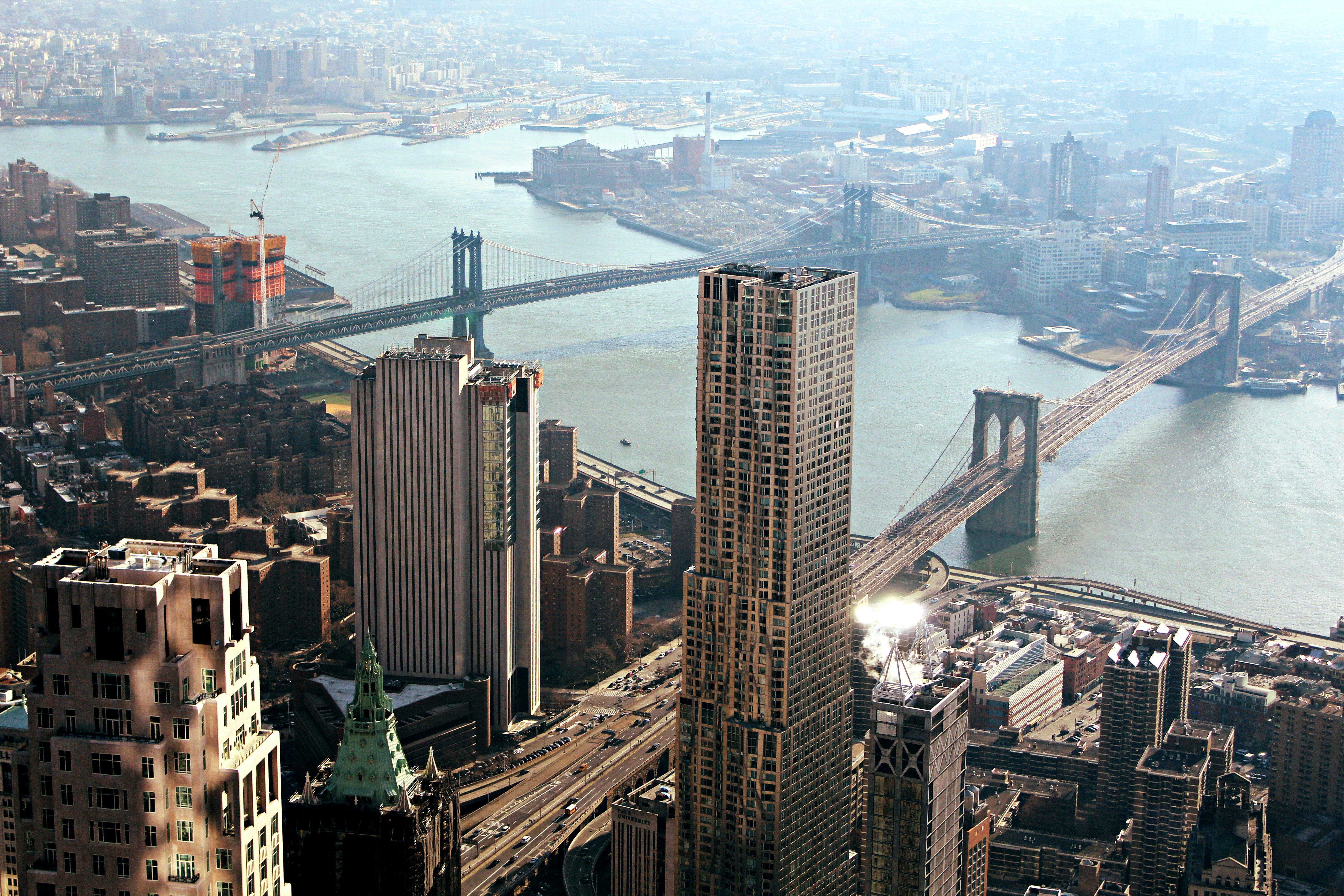 Aerial shot over the skyscrapers and bridges of NYC