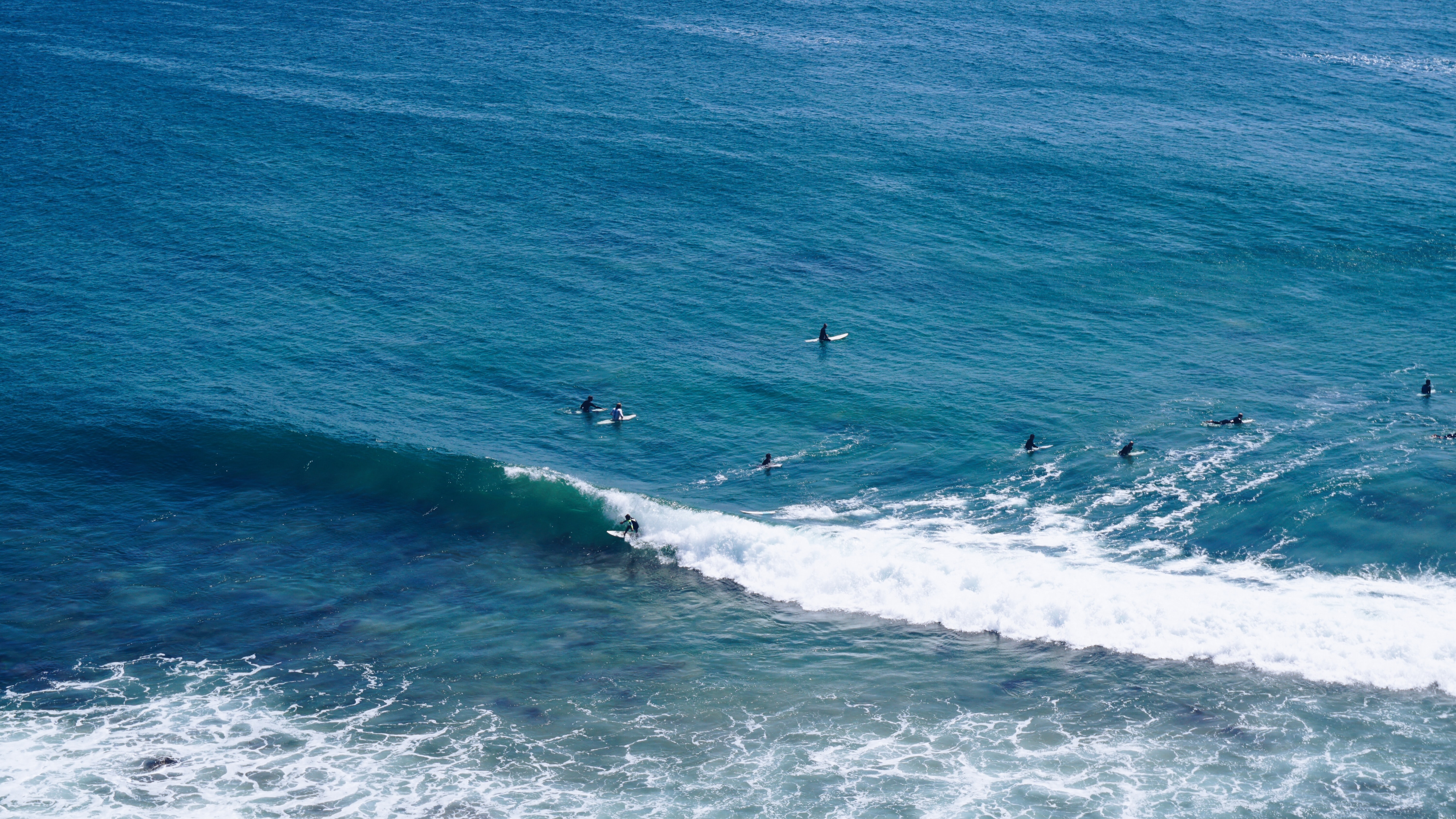 aerial shot of person surfing on ocean