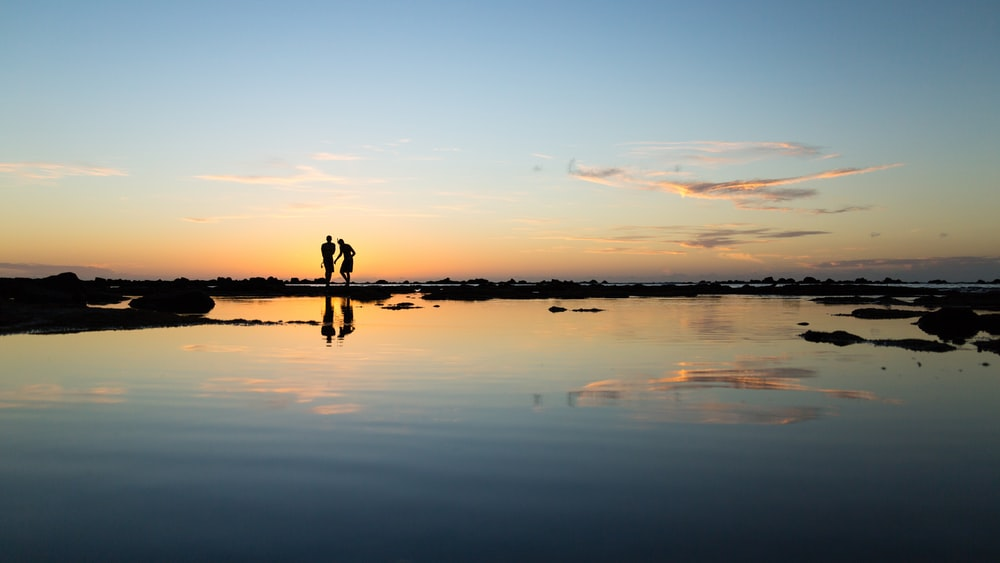 rule of thirds photography of silhouette of two persons